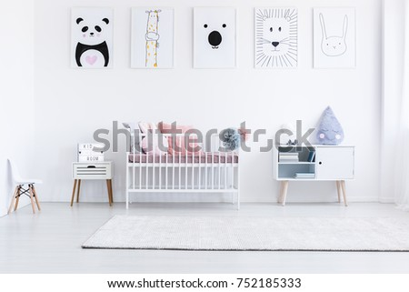 Panda and tiger drawing on white wall in girl's bedroom with white cabinet, chair and carpet