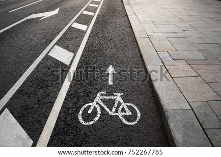 Separate bicycle lane for riding bicycles. White painted bike on asphalt. Ride ecological green urban transport Royalty-Free Stock Photo #752267785