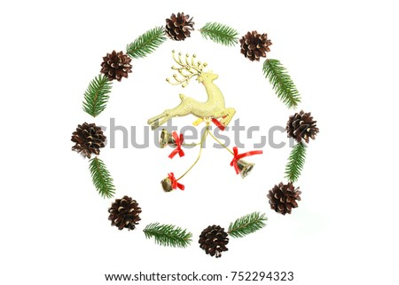 Christmas wreath was made minimalist style from pine cones and evergreen fir branches on the white background. Top view #752294323