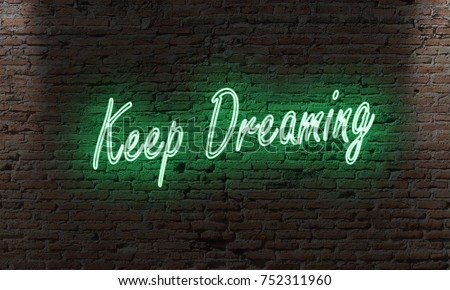 neon letter sign with the quote keep dreaming on a brick wall in the dark motivation concept