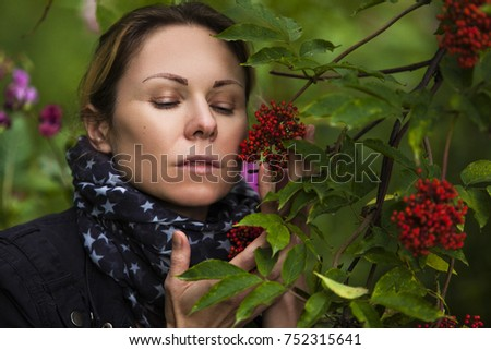 portrait of a girl with grapes #752315641