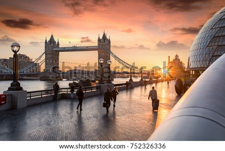 The Tower Bridge in London during sunrise and people rushing to their work #752326336