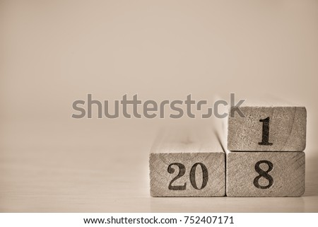 Happy New Year concept for 2018, Wood block number 2018 on wood table background and copy space for art work design or add text message. #752407171