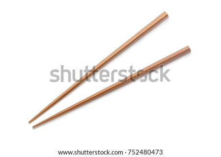 Wooden Chopsticks isolated on white background. Asian Food Chopsticks #752480473