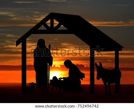Christmas nativity scene, black silhouettes against a sunset background. #752496742