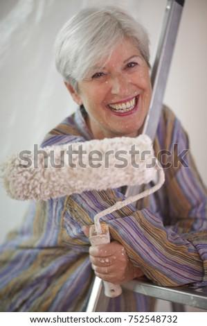 Mature woman doing DIY #752548732