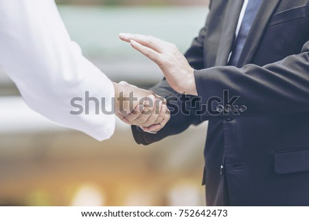 handshake-Pictures of people greeting each other or congratulations or welcome. Friendship is good, believe in work to achieve or success concept. #752642473
