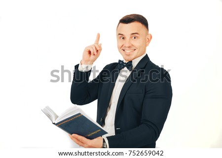 Young man with a book in hands on a white background. Conception business of idea from a book #752659042