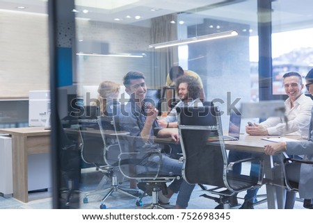 Group of a young business people discussing business plan at modern startup office building #752698345