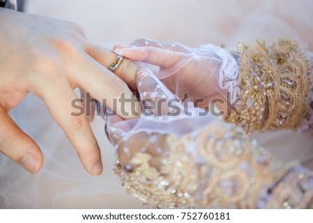 Muslim bride wears the ring groom #752760181