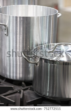 Metal stainless steel pan on a kitchen stove #752772511