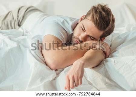 handsome young man relaxing in bed at morning #752784844