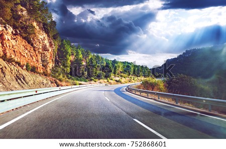 Highway to destiny.Tranquility and safety driving.Road and travel concept.Sunset landscape and mountains. #752868601