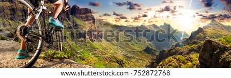 Extreme sport and adventures.Exercise and healthy lifestyle. Biker and sunset landscape.Recreation and leisure in outdoor Royalty-Free Stock Photo #752872768
