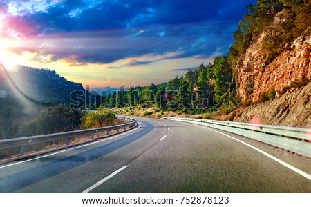 Highway to destiny.Tranquility and safety driving.Road and travel concept.Sunset landscape and mountains #752878123