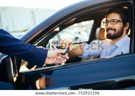 Young and handsome businessman buying used car Royalty-Free Stock Photo #752921596