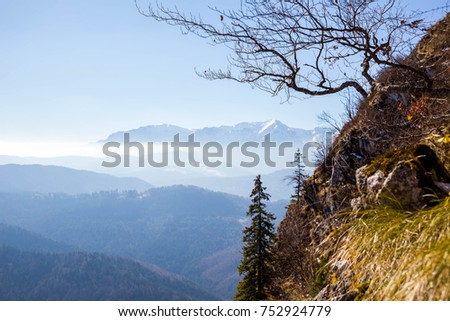 Bucegi mountains landscape in Romania Carpathians in autumn. Fantastic landscape with big Mountains in the background. Autumn scenery. Beautiful autumn colors. Big mountain summit covered with snow. #752924779