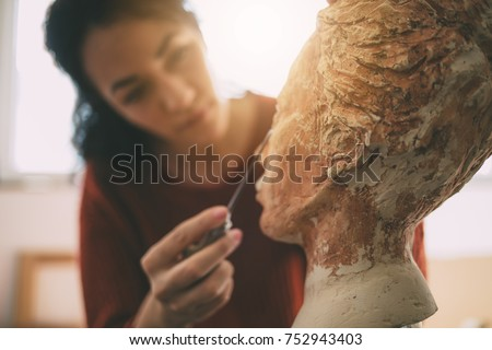 Artist is working in an atelier. Art and Sculpture. Royalty-Free Stock Photo #752943403