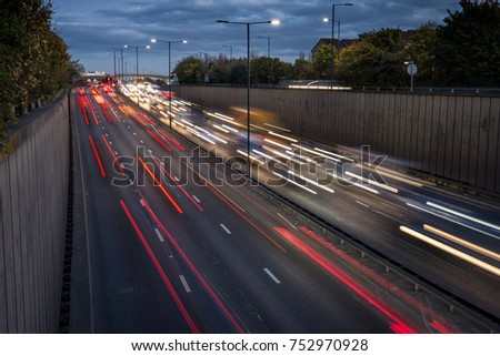 Heavy traffic at rush hour as drivers leave London on the A40 highway, leaving motion blur #752970928