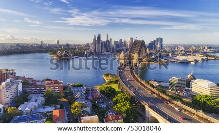Cahill express way to the Sydney Harbour bridge across Sydney harbour towards city CBD landmarks in aerial eleveated wide view under blue morning sky. #753018046