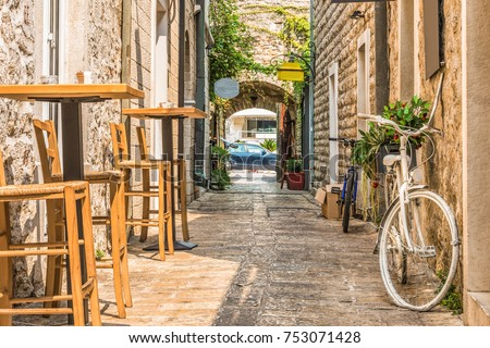 Old Town  Budva, Montenegro. The first mention of this city - more than 26 centuries ago. We see ancient houses, a very narrow street, cafes, shops. #753071428
