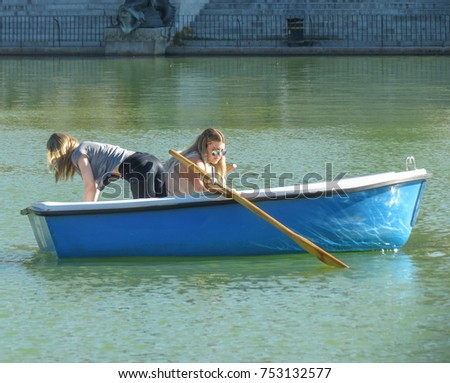 MADRID, SPAIN - CIRCA OCTOBER 2017: unidentified girls on a boat at the Retiro park lake #753132577