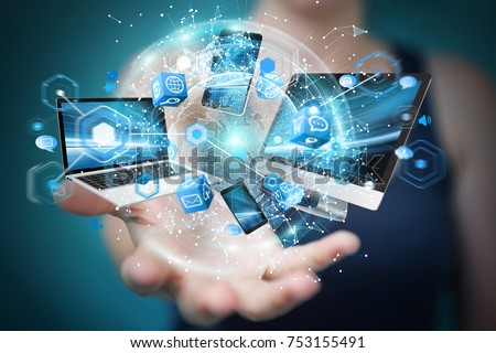 Tech devices connected to each other by businesswoman on blurred background 3D rendering #753155491