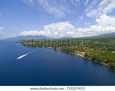 Aerial photos at the USAT Liberty Wreck  in Tulamben, Bali, Indonesia, a popular scuba diving destination. #753257413