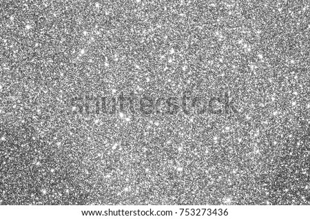glittery bright shimmering background perfect as a silver backdrop Royalty-Free Stock Photo #753273436