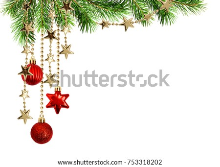 Christmas arrangement with green pine twigs and hanging red decorations isolated on white background Royalty-Free Stock Photo #753318202