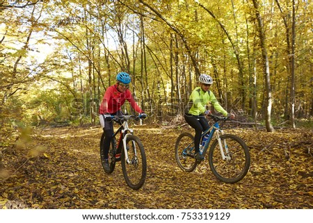 Full length of two female cyclist enjoy mountain biking together on the forest.  #753319129