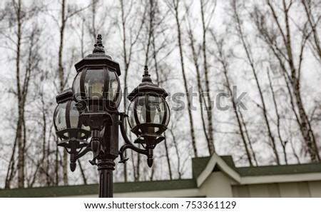 Vintage black lantern on a city street #753361129