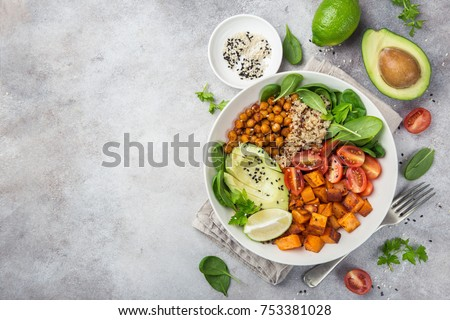 healhty vegan lunch bowl. Avocado, quinoa, sweet potato, tomato, spinach and chickpeas vegetables salad. Top view Royalty-Free Stock Photo #753381028