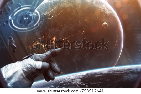 Brave astronaut spacewalking at the alien planet orbit. People in space. Elements of this image furnished by NASA #753512641