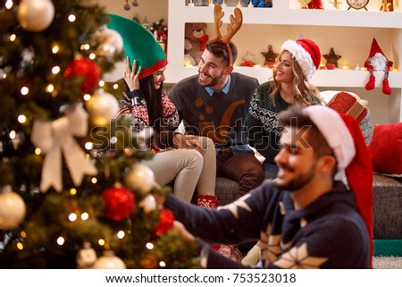 young friends having fun and celebrating Christmas #753523018