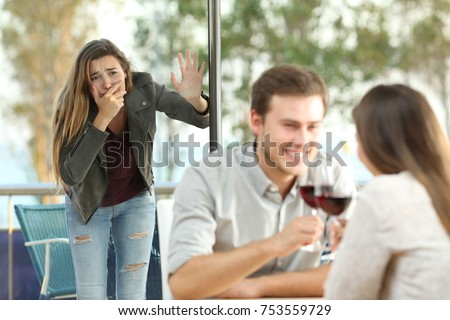 Cheater caught by his sad girlfriend dating with another girl in a coffee shop #753559729