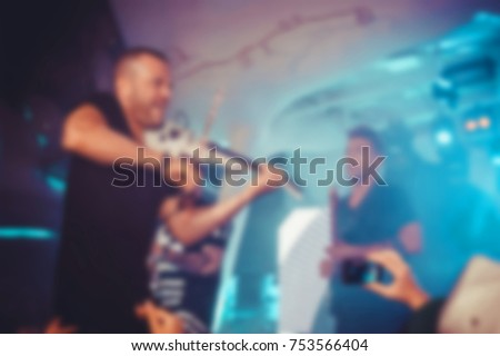 Blurred for background. night club party. Artist performs club show from stage during concert at nightclub. Artist on club stage during night party #753566404