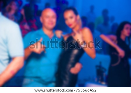Blurred for background. club party. People smiling and posing on cam during concert in night club party. Man and woman have fun at club. Boy and girl at night club party #753566452