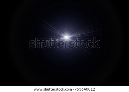 digital lens flare,sun burst on black background. #753640012
