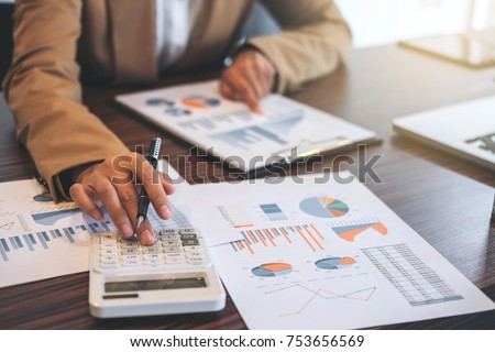Business Financing Accounting Banking Concept, businesswoman doing finances and calculate about cost to real estate investment and in other, tax system. #753656569