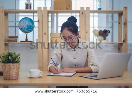 Asian woman working at home #753665716