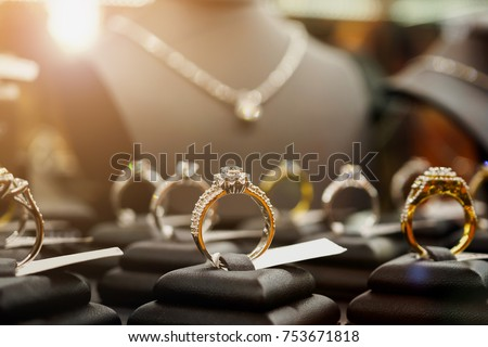 Jewelry diamond rings and necklaces show in luxury retail store window display showcase #753671818