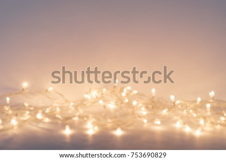 Christmas background with warm lights and copy space. Background with christmas lights. Christmas garland. New Year.