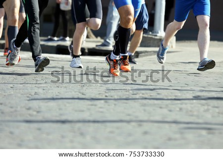 athletes run marathons on the pavement #753733330