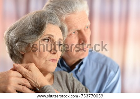 Portrait of sad senior couple looking away #753770059
