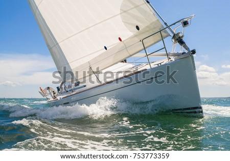 Close up of sailing boat, sail boat or yacht at sea Royalty-Free Stock Photo #753773359