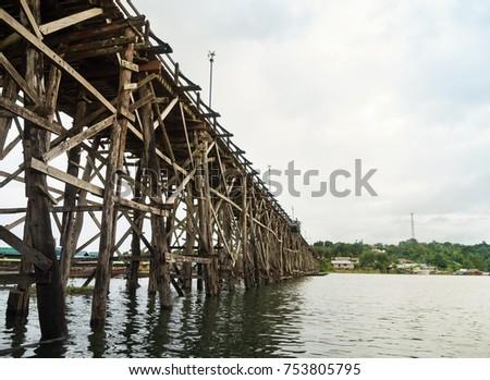 Landscape of The wooden bridge (Mon bridge) at Sangkhlaburi, Kanchanaburi,Thailand. It's the second longest wooden bridge in the world. #753805795
