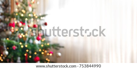 out of focus holiday background with christmas tree