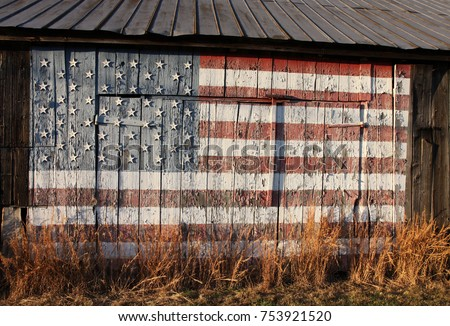 old wooden tobacco barn with United States flag painted on side, Calvert County, Southern Maryland, USA