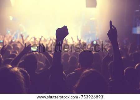 The audience watching the concert on stage in big concert club. #753926893